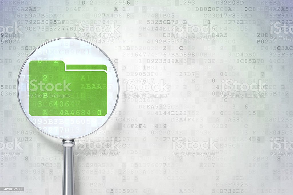 Magnifying glass over green folder on digital background stock photo