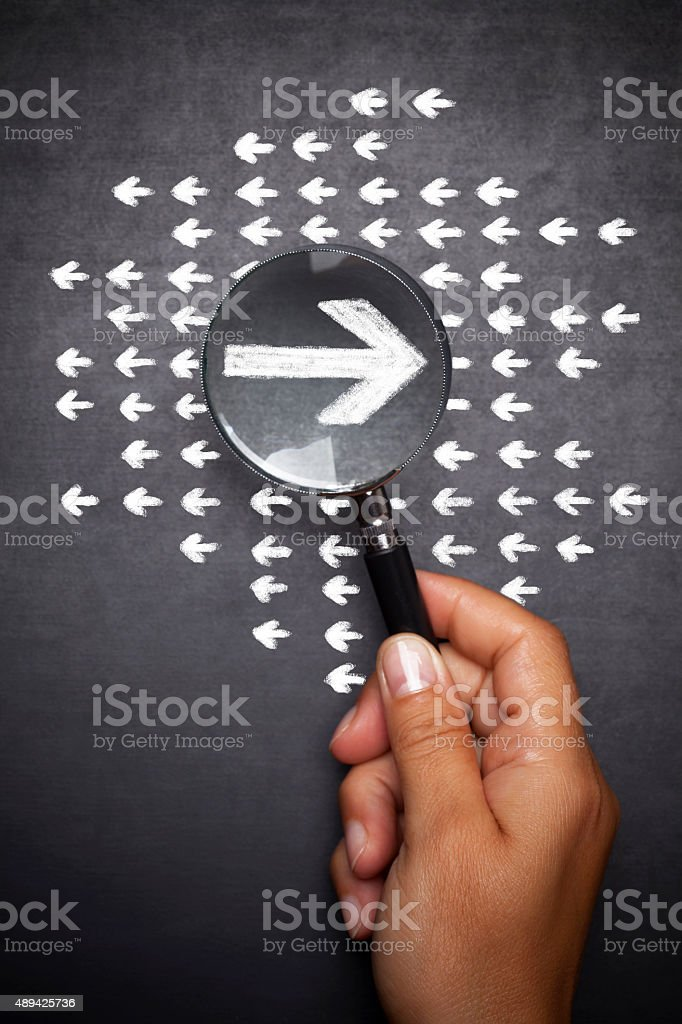Magnifying glass searching right way stock photo