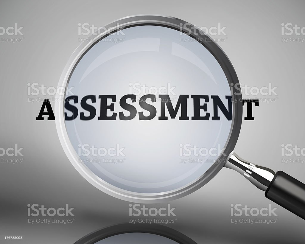 Magnifying glass showing assessment word stock photo