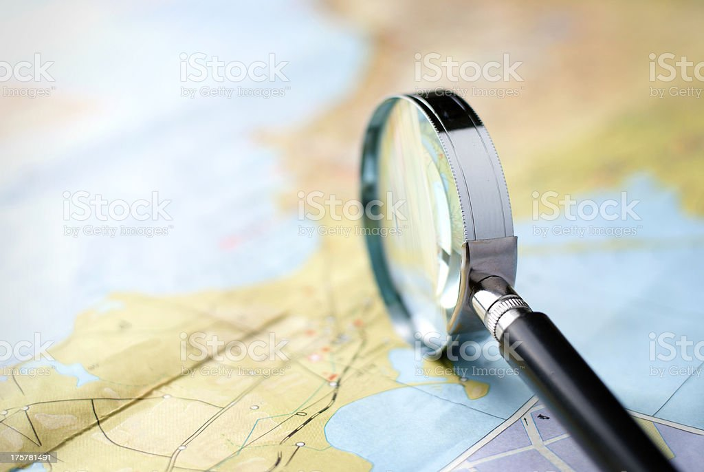 Magnifying glass standing on edge royalty-free stock photo