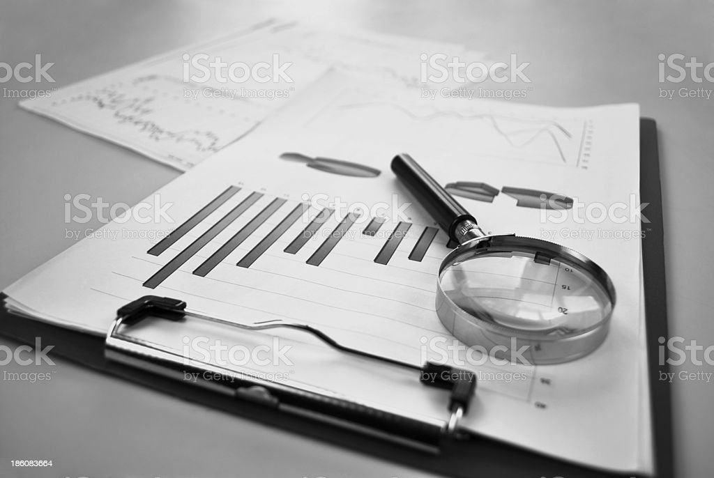 Magnifying glass with a bar graph royalty-free stock photo