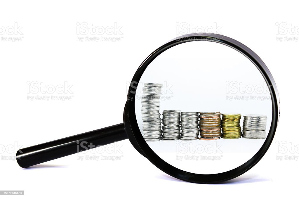 magnifying glass with coin white background. For business money stock photo