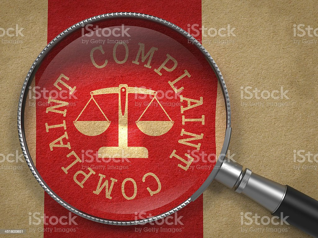 Magnifying Glass with Complaint Concept. stock photo