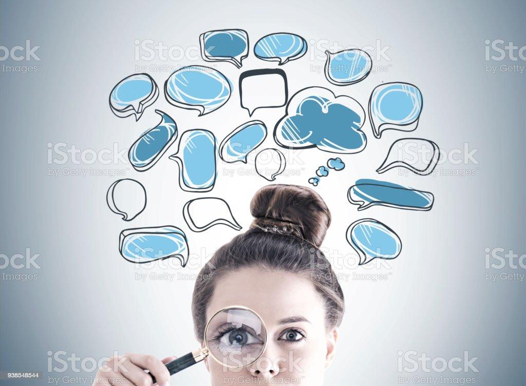 Magnifying glass woman, speech bubbles stock photo
