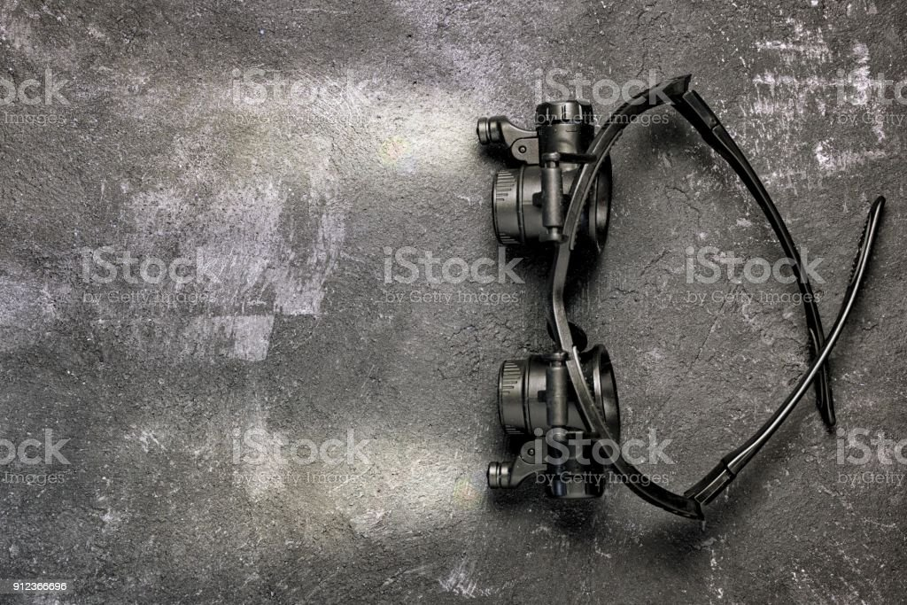 magnifying glasses microscope on a black background, with the included light on them and the light beams, the concept of enlightenment and illumination of knowledge in education. stock photo