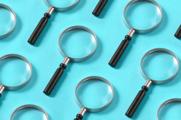 Magnifying Glasses on Blue Background stock photo
