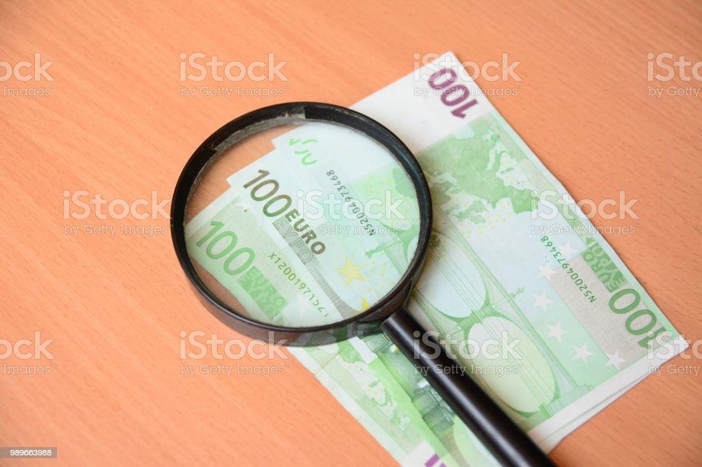Magnifying hundred euros stock photo