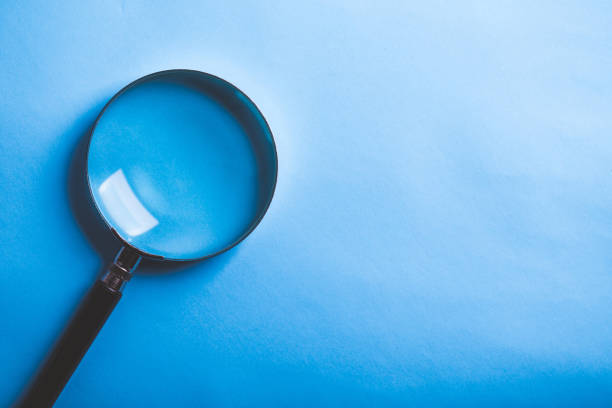 Magnifying Isolated On Blue Background