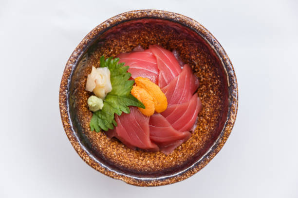 maguro-don with sea urchin served with wasabi and prickled ginger. - 丼物 ストックフォトと画像