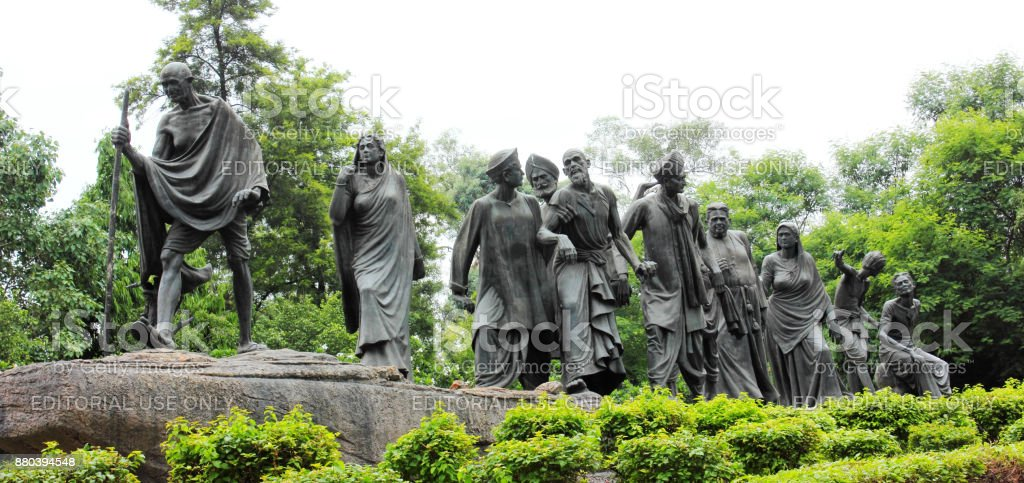 Mahatma Gandhi statue depicting Dandi March in New Delhi, India stock photo