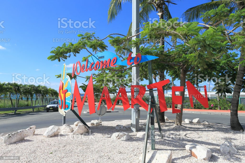 Maho beach and Welcome board stock photo