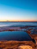 Ocean cliff view during sunrise.
