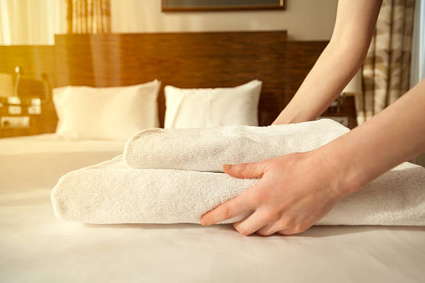 maid changing towels in hotel room - guest stock pictures, royalty-free photos & images