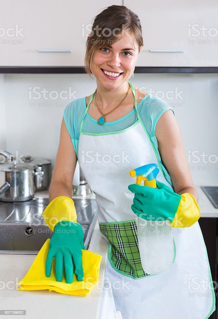 maid doing professional clean-up stock photo