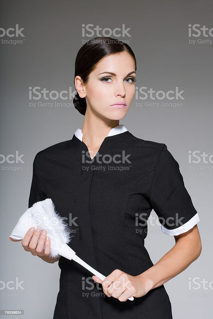 Maid holding a duster 免版稅 stock photo