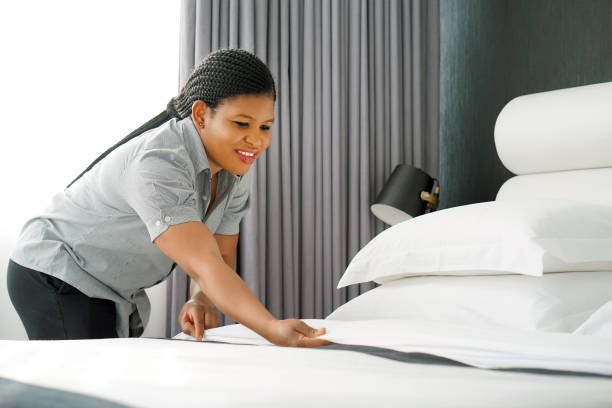 maid making bed - maid stock pictures, royalty-free photos & images