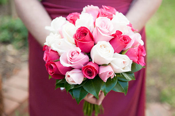Maid of honor holding bouquet stock photo