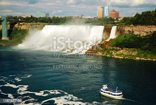 Niagara Falls, ON, Canada August 7 The Maid of the Mist tour boat cruises past American Falls in Niagara Falls, Ontario