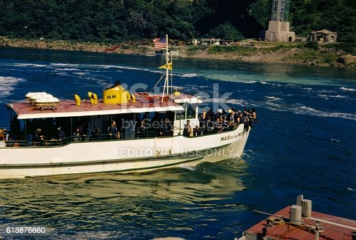 Niagara Falls, United States - January 1, 1960: Tourists crowd the bow of the Maid of the Mist on a tour of Niagara Falls, New York, 1960