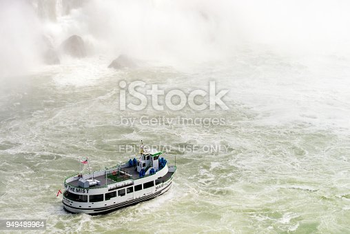 Niagara, Canada - Tourists on the deck of the Maid of the Mist tour boat, at the base of Niagara's Horseshoe Falls.