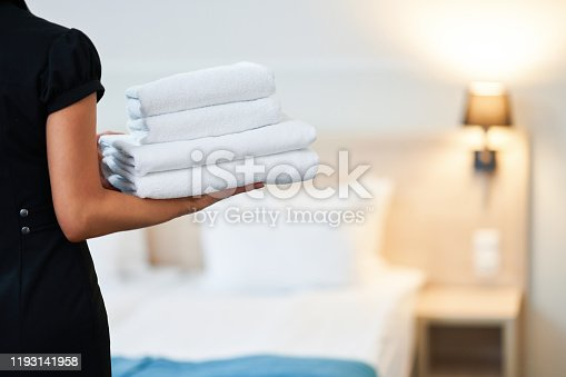 Picture of maid with fresh towels in hotel room