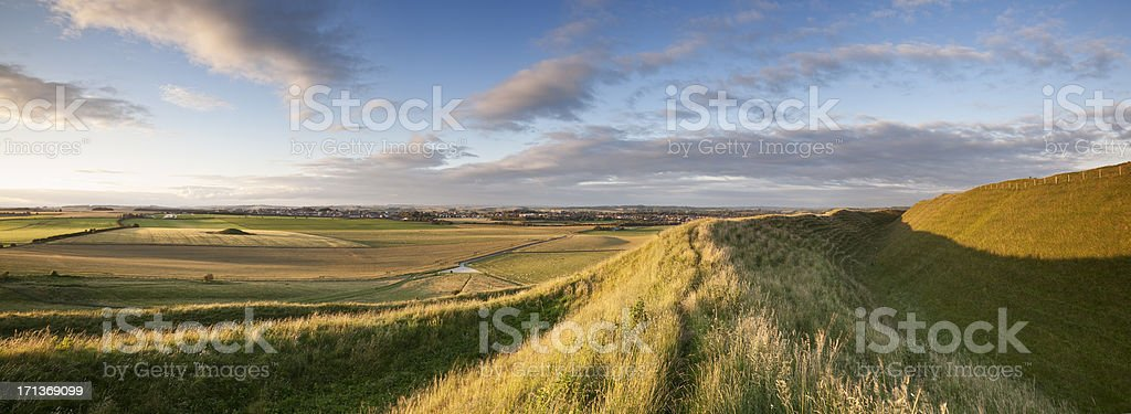 Maiden Castle, Dorset lit by evening sunshine stock photo
