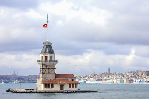 Maidens Tower on Bosphorus, Uskudar. Cityscape of Istanbul, Turkey. Cloudy weather