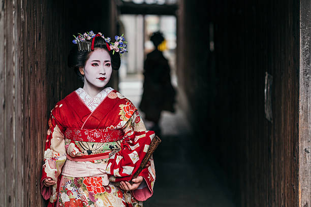 maiko geishas walking on a street of gion - geisha girl stock photos and pictures