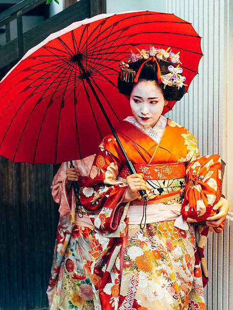 maiko girl portrait - geisha girl stock photos and pictures