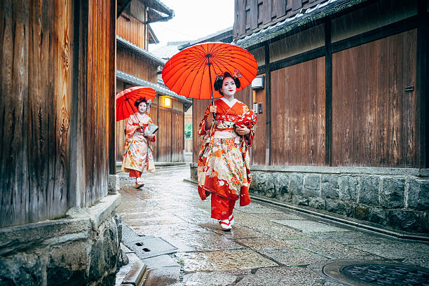 maiko women walking in kyoto - geisha girl stock photos and pictures