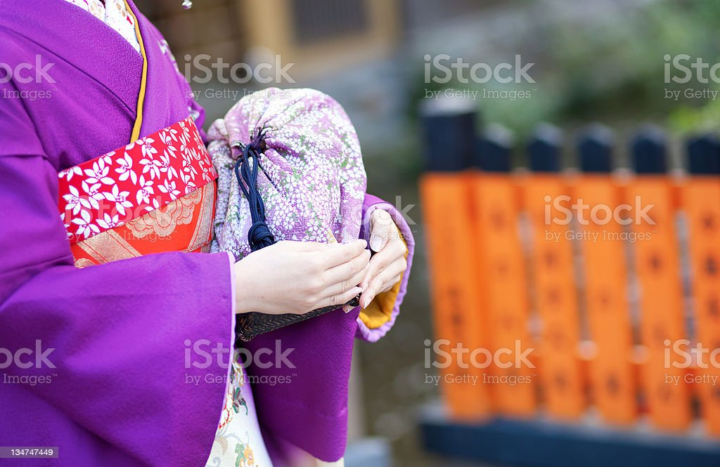 Maiko's hands holding the traditional bag stock photo