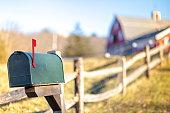 American mailbox. rural view, blurred background