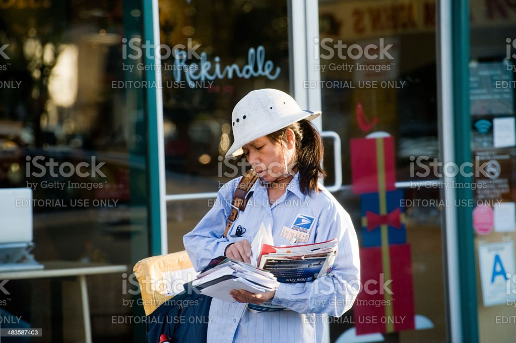 mail carrier at work stock photo