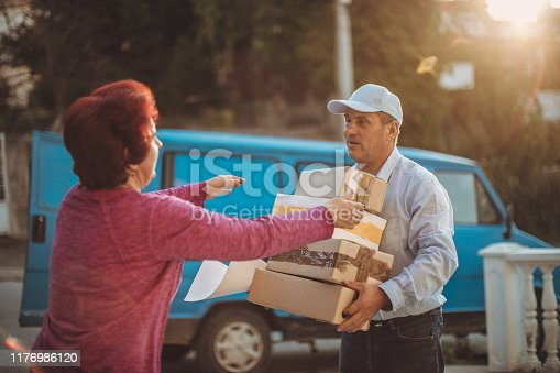 891482746istockphoto Mail delivery to your home address 1176986120