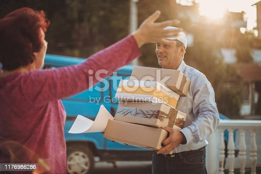 891482746istockphoto Mail delivery to your home address 1176986286