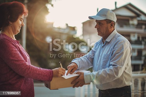 891482746istockphoto Mail delivery to your home address 1176986357