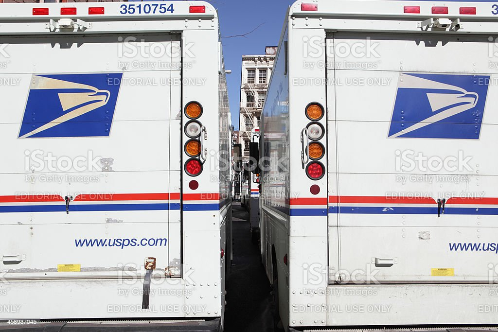 USPS mail delivery trucks NYC stock photo