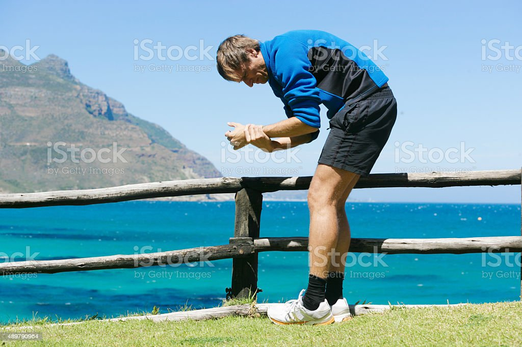 Mail jogger having severe pain in his wrist stock photo