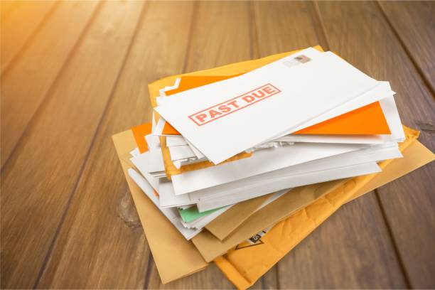 Mail. Pile of envelopes with overdue utility bills isolated on white debt stock pictures, royalty-free photos & images