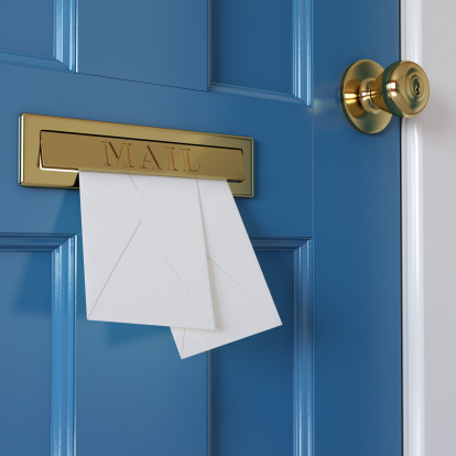 Mail coming through a letterbox in a blue door. Very high resolution 3D render.