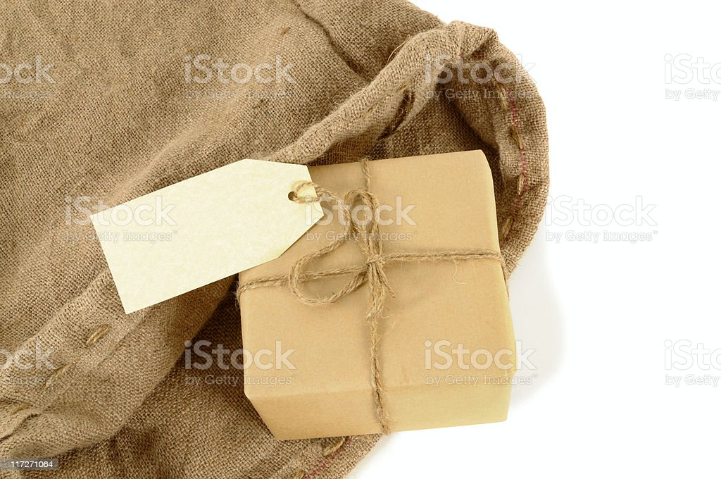 Mail sack with wrapped package royalty-free stock photo