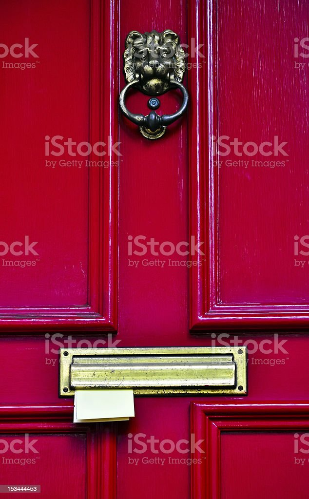 mail sticking in a red wooden door royalty-free stock photo