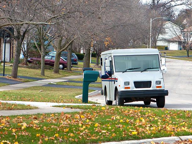 почта грузовик в пригородах - postal worker стоковые фото и изображения