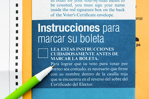 Mail Voting Ballot Instructions In Spanish Stock Photo - Download Image Now
