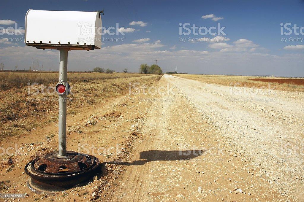 Mailbox Along Dirt Road stock photo