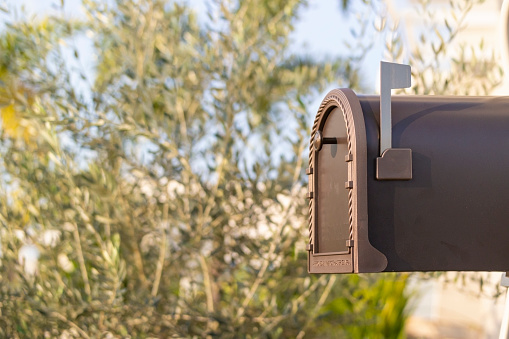 Photo of a mailbox in front a house.