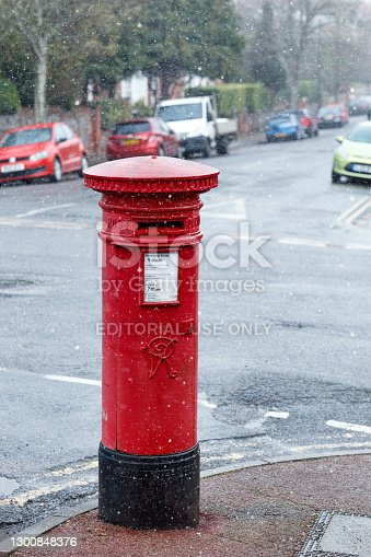 Eastbourne, United Kingdom - Feb 07, 2021: Red Mailbox in the UK