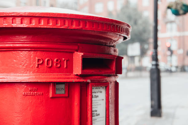Mailbox in the UK A red UK mailbox mailbox stock pictures, royalty-free photos & images