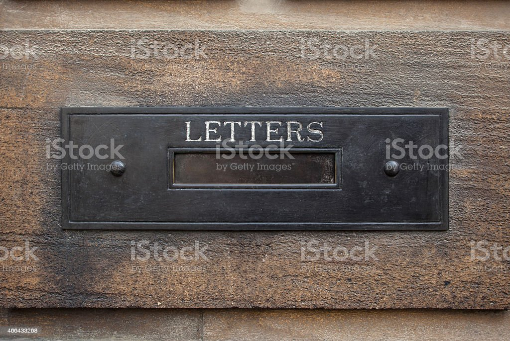 Mailbox on brick wall stock photo