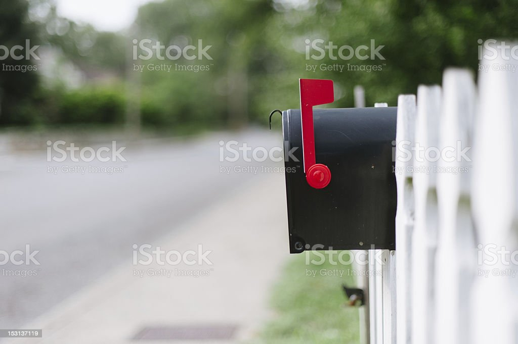 Mailbox On White Fence stock photo